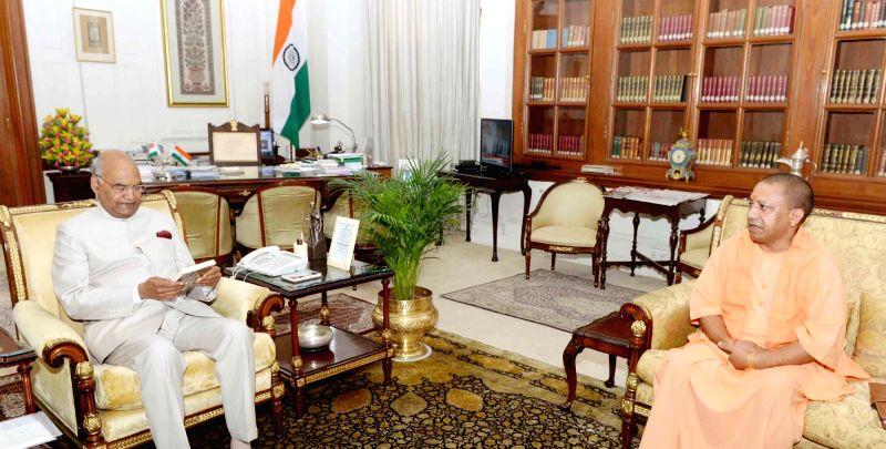 Uttar Pradesh Chief Minister Yogi Adityanath calls on President Ram Nath Kovind at Rashtrapati Bhavan, in New Delhi on July 12, 2018. - Yogi Adityanath and Nath Kovind
