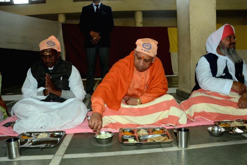 Uttar Pradesh Chief Minister Yogi Adityanath take 'Langar' on Guru Ravidas Jayanti in Varanasi on Jan 31, 2018. - Yogi Adityanath