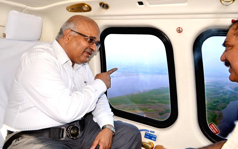 Uttar Pradesh Chief Secretary Alok Ranjan during an aerial inspection of flood hit districts of the state on Aug 26, 2014.
