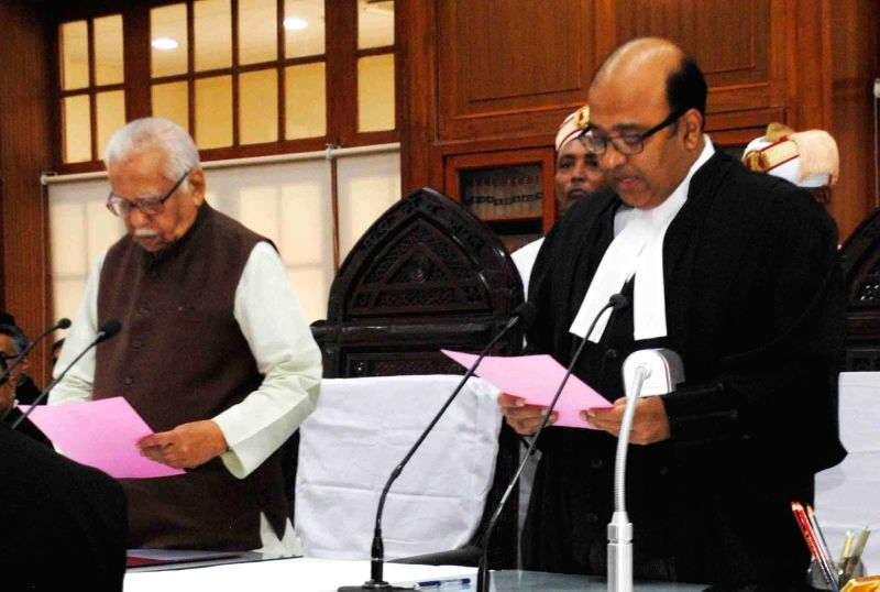 Uttar Pradesh Governor Ram Naik administers oath of Chief Justice of Allahabad High Court to Justice Dilip Babasaheb Bhosale in Allahabad on July 30, 2016.