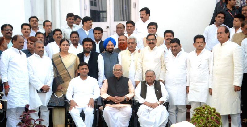 Uttar Pradesh Governor Ram Naik, Chief Minister Akhilesh Yadav and Samajwadi Party chief Mulayam Singh Yadav with the newly appointed ministers of the Uttar Pradesh government at Raj Bhawan ... - Akhilesh Yadav and Mulayam Singh Yadav