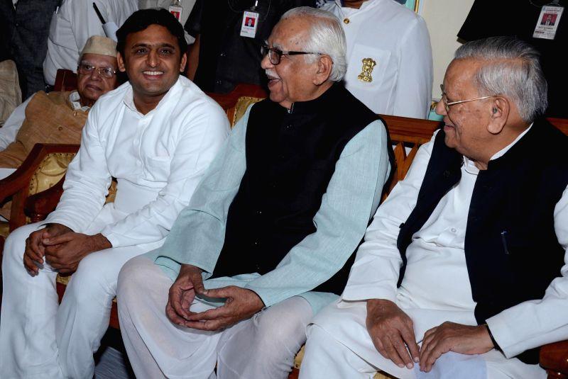 Uttar Pradesh Governor Ram Naik, Uttar Pradesh Chief Minister Akhilesh Yadav and others during an iftar party at Raj Bhavan in Lucknow on July 27, 2014. - Akhilesh Yadav
