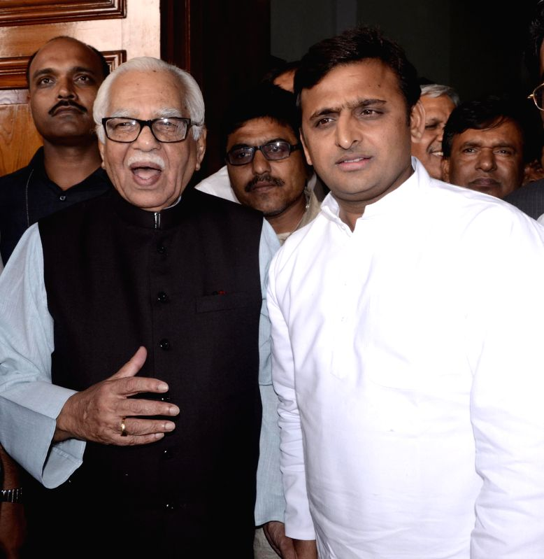 Uttar Pradesh Governor Ram Naik with Uttar Pradesh Chief Minister Akhilesh Yadav after taking oath as the Governor in Lucknow on July 22, 2014. - Akhilesh Yadav