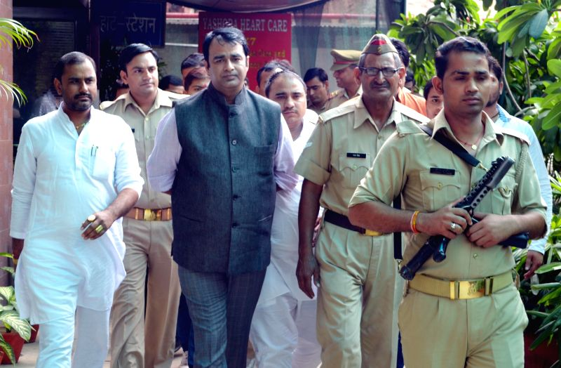 Uttar Pradesh Legislator Sangeet Som comes out after meeting the victim of alleged gangrape and conversion at Yashoda hospital in Ghaziabad on Aug 8, 2014.