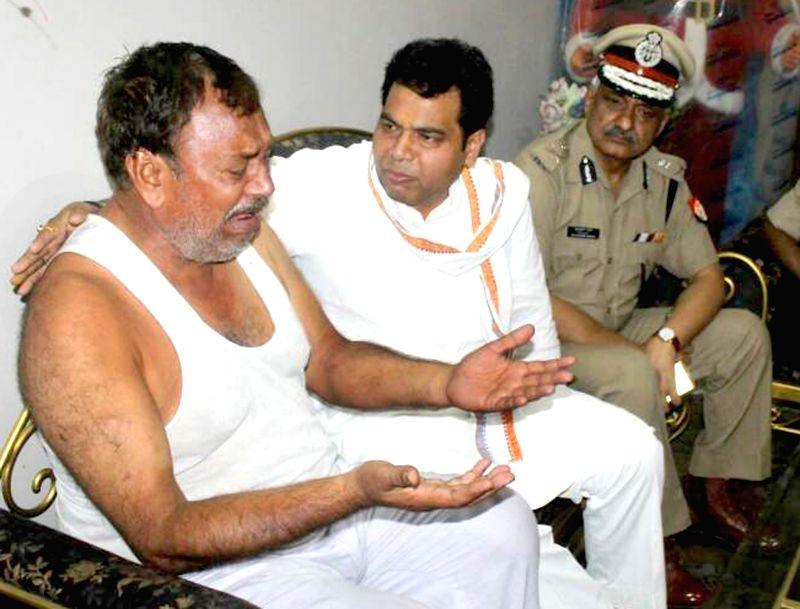 Uttar Pradesh Minister Shrikant Sharma consoles grief struck family members of the two bullion traders who on 15th May were shot dead in Mahura; on May 17, 2017. - Shrikant Sharma