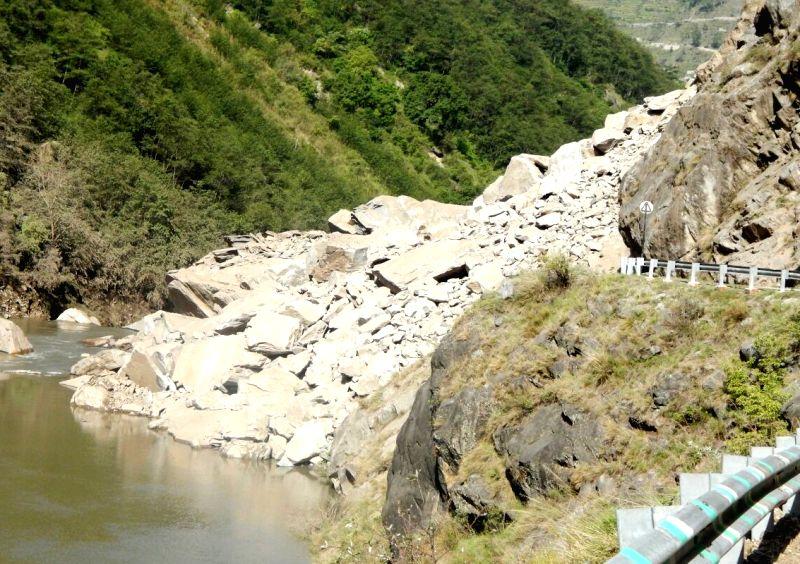Boulders block Rishikesh-Badrinath Highway after a landslide in Uttarakhand on April 30, 2015.