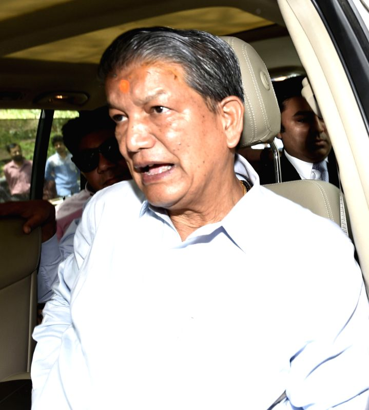 Uttarakhand Chief Minister Harish Rawat arrives to appear before CBI in connection with an alleged political horse-trading case in New Delhi, on May 24, 2016. - Harish Rawat