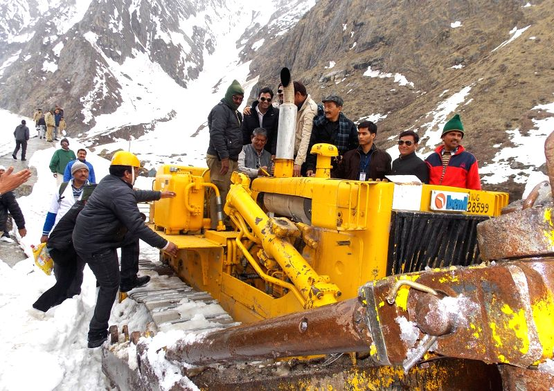 Uttarakhand Chief Minister Harish Rawat reviews the conditions of Badrinath road in Uttarakhand, on April 20, 2015.