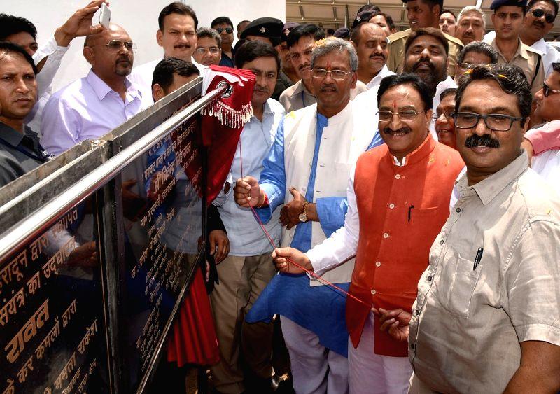 Uttarakhand Chief Minister Trivendra Singh Rawat inaugurates 100 Mega Watt Solar Power Plant near Bhagwanpur in Haridwar on April 21, 2017. - Trivendra Singh Rawat
