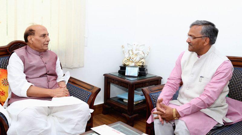 Uttarakhand Chief Minister Trivendra Singh Rawat calls on Union Home Minister Rajnath Singh, in New Delhi on June 11, 2017. - Trivendra Singh Rawat and Rajnath Singh