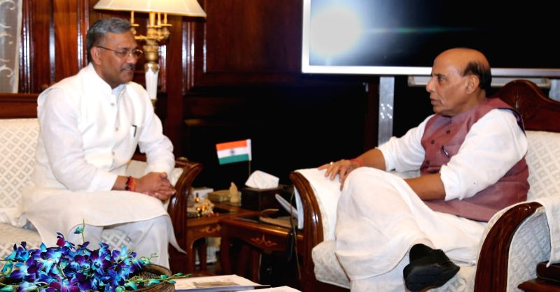 Uttarakhand Chief Minister Trivendra Singh Rawat calls on the Union Home Minister Rajnath Singh in New Delhi on Aug 11, 2017. - Trivendra Singh Rawat and Rajnath Singh