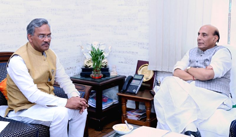 Uttarakhand Chief Minister Trivendra Singh Rawat calls on Union Home Minister Rajnath Singh, in New Delhi on July 18, 2018. - Trivendra Singh Rawat and Rajnath Singh