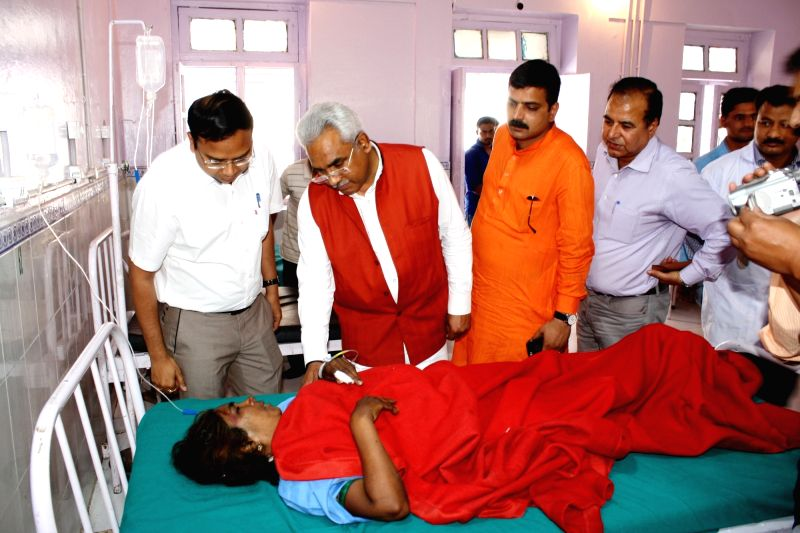 Uttarakhand Minister Madan Kaushik meets victim of Uttarkashi bus accident being treated in Dehradun on May 24, 2017. - Madan Kaushik