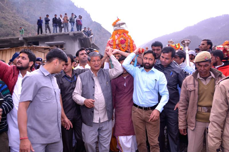 Uttarakhand Chief Minister Harish Rawat carries the doli of Yamunotri to the portals of Yamunotri on April 21, 2015.