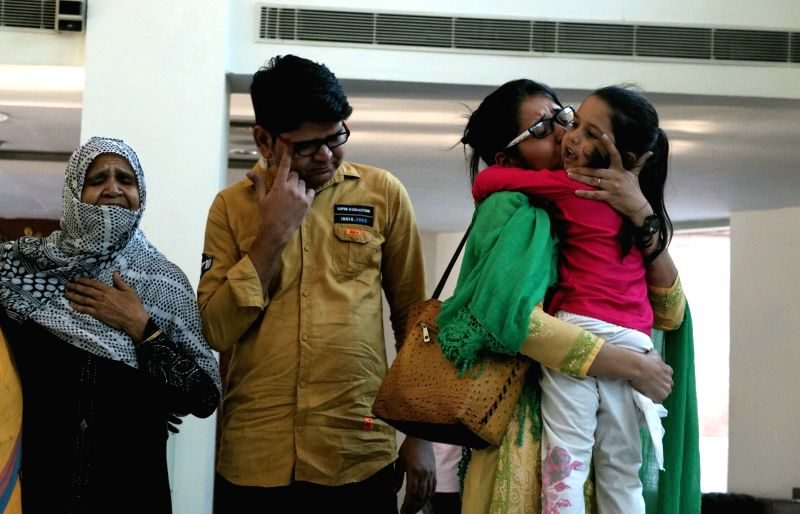 Uzma Ahmed, who alleged she was forced to marry a Pakistani man gets emotional on being re-united with her child in New Delhi, on May 25, 2017.