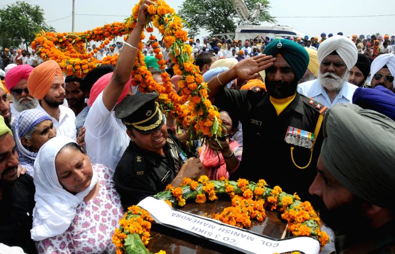 Vain Poin: Funeral of Naib Subedar Paramjit Singh one of the two Indian soldiers whose body was mutilated along the Line of Control on 1st May, 2017 underway at village Vain Poin, some 40 km away ...