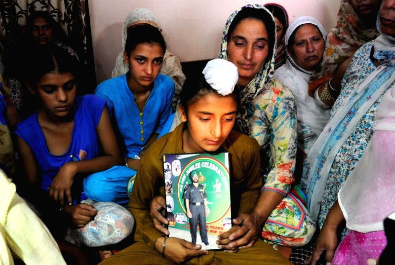 Vain Poin: Grief struck family members of Naib subedar Paramjit Singh one of the two Indian soldiers whose body was mutilated along the Line of Control at their home in Tarn Taran of Punjab on May 1, ... - Paramjit Singh