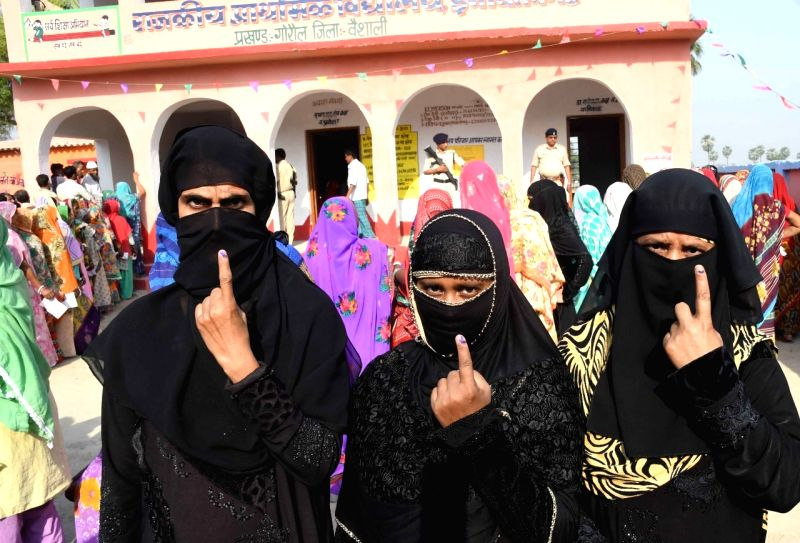 Vaishali: Burqa clad women show their forefingers marked with indelible ink after casting vote during the sixth phase of 2019 Lok Sabha elections, in Vaishali, Bihar on May 12, 2019.