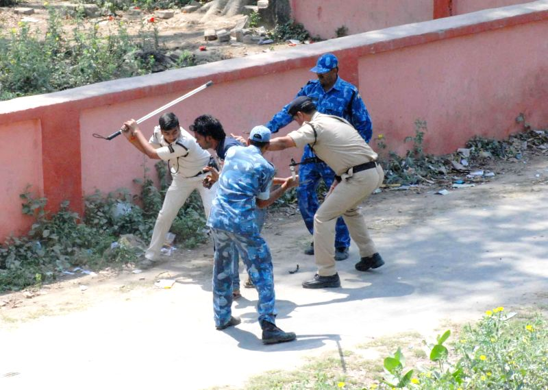 Police crackdown on people aiding students cheat in their board exams at an examination centre in Bihar's Vaishali on March 20, 2015.