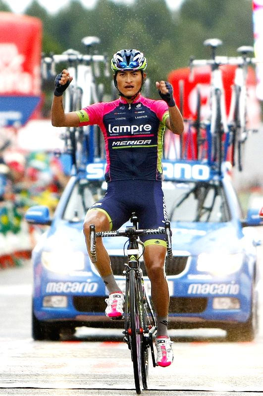 Colombian cyclist Winner Anacona celebrates after finishing the ninth stage of Carboneras of Guadazaon/Aramon Valdelinares of Spain Tour in the Valdelinares ...