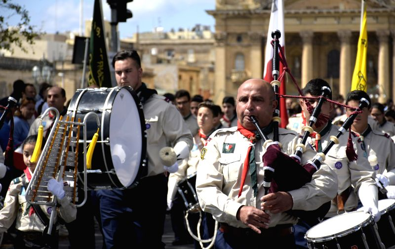 VALLETTA, April 23, 2017 - Scouts play musical instruments whilst marching during the annual scout parade in Valletta, the capital city of Malta on April 23, 2017. (Xinhua/Mark Zammit Cordina)