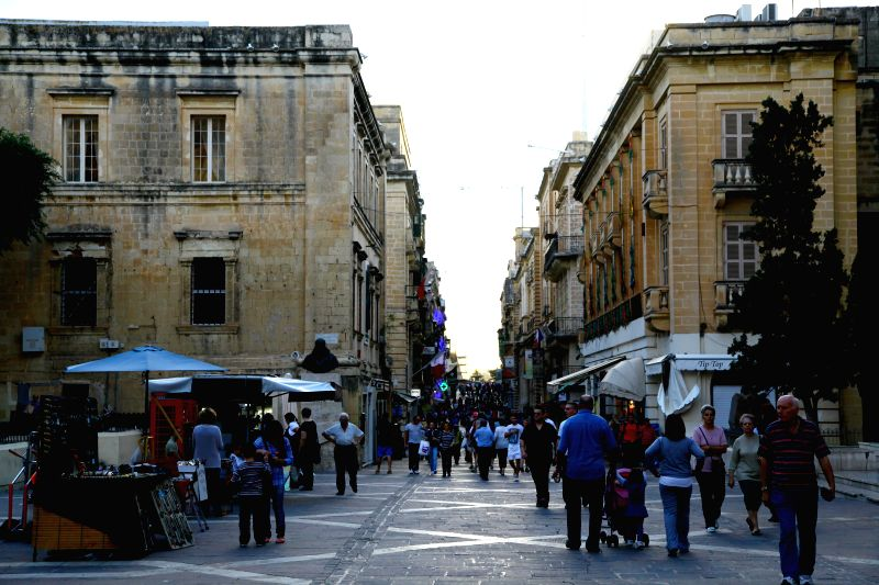 Photo taken on Nov. 8, 2013 shows the Republic Street of Valletta, capital of Malta. Built after the Great Siege of 1565 and named after Grandmaster Jean Parisot ..