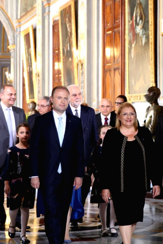 VALLETTA, June 6, 2017 - Malta's President Marie-Louise Coleiro-Preca (1st R) and Joseph Muscat (1st L) walk into the Grand Master's Palace in Valletta, capital of Malta, on June 5, 2017. Joseph ...