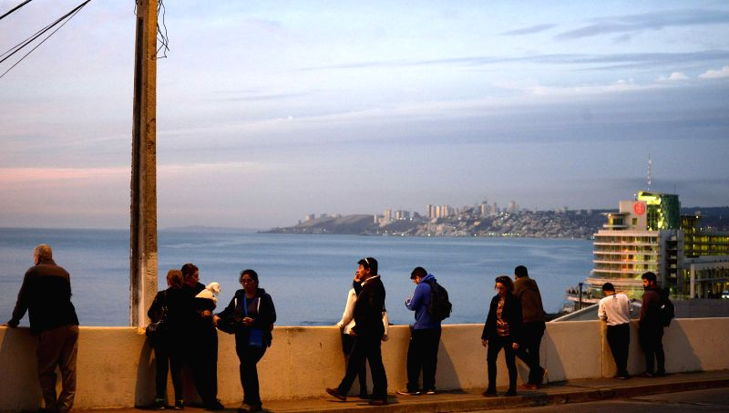 VALPARAISO, April 25, 2017 - People stand on the pier after an earthquake in Valparaiso, Chile, on April 24, 2017. An earthquake measuring 7.1 on the Richter scale jolted an area 38 kilometers west ...