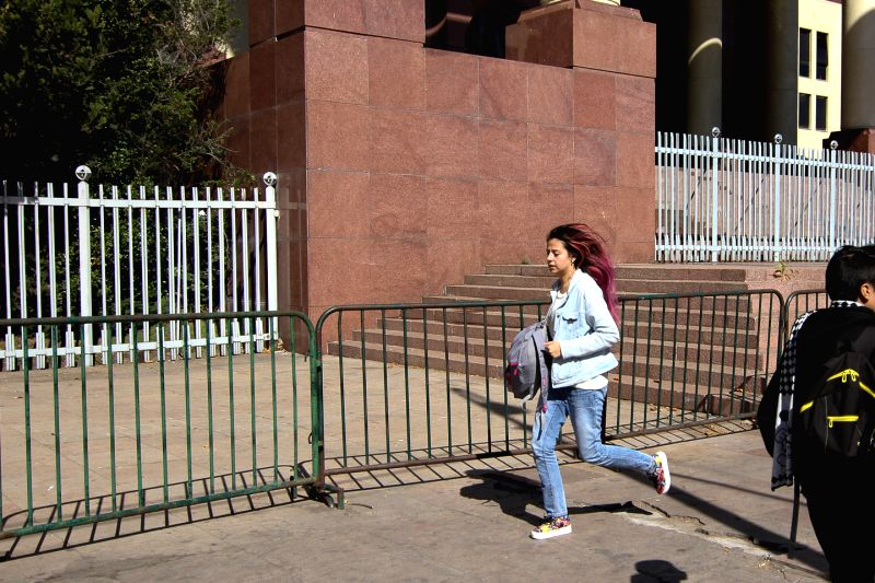 VALPARAISO, April 29, 2017 - A woman runs after an earthquake in Valparaiso, Chile, on April 28, 2017. A 5.7 magnitude earthquake jolted Valparaiso on Friday.