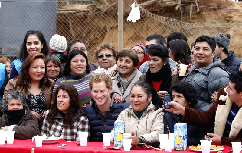 British Prince Harry (R Front) visits the XI Firefighters Company of Valparaiso, in Valparaiso, Chile, on June 28, 2014.