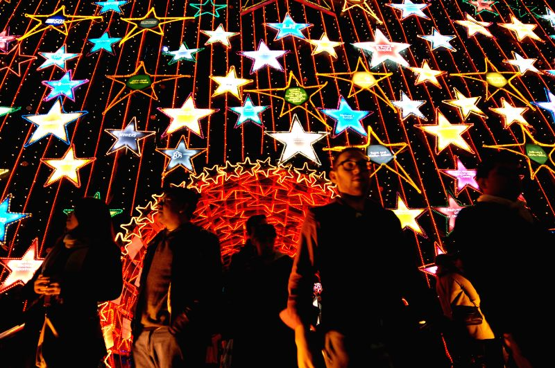 A girl poses at the Christmas Lights of Hope charity initiative at St. Paul's Hospital in Vancouver, Canada, Dec. 6, 2014. The 17th annual fireworks display kicked off the annual ...