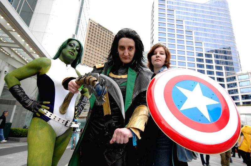 People dressed as their favorite characters pose during the Fan Expo 2014 in Vancouver, Canada, April 18, 2014. Fan Expo is an annual multi-genre fan convention,