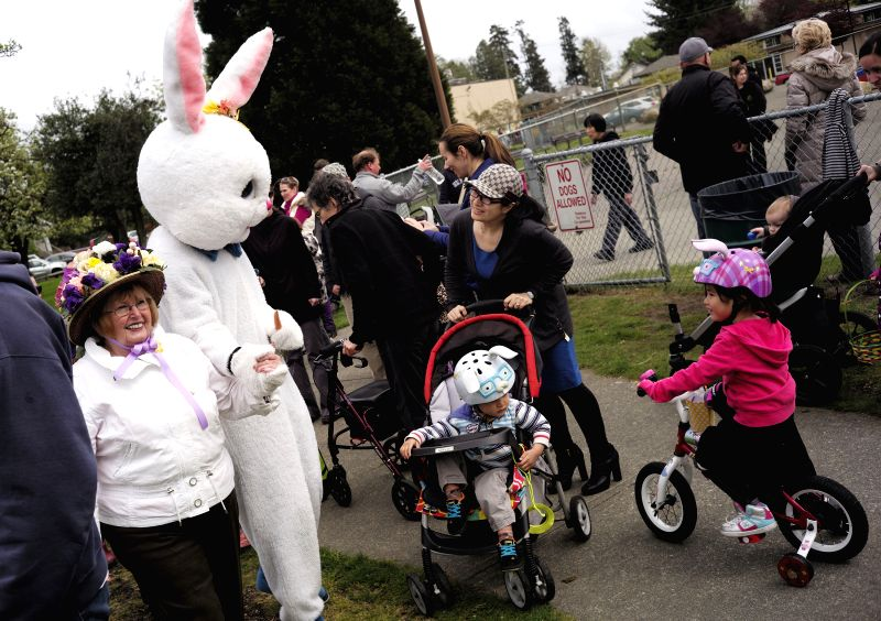A bunny mascot joins the Easter parade during the Easter event in Delta, Canada, April 20, 2014. People participate in the annual Easter parade and egg hunt to ..