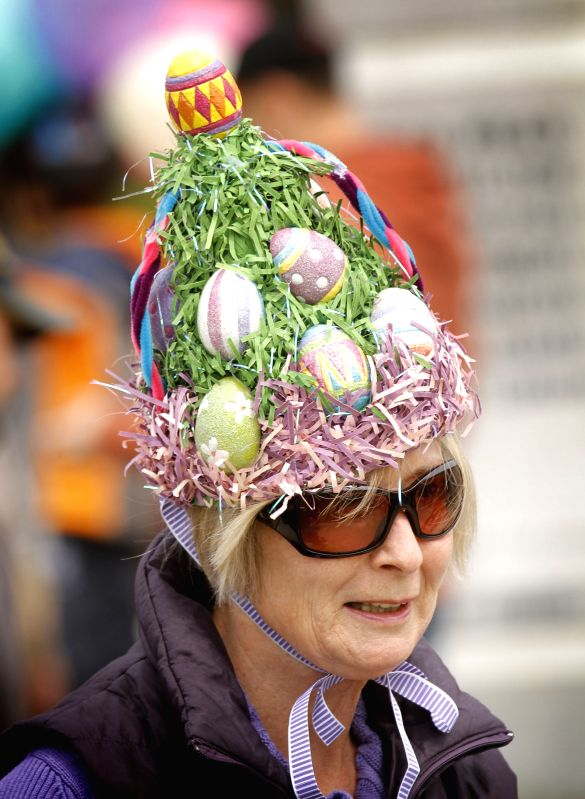 A resident joins the Easter parade with her decorated hat during the Easter event in Delta, Canada, April 20, 2014. People participate in the annual Easter ...