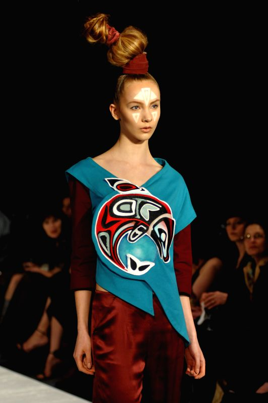 A model presents a creation by Georgian designer Kakha Beri on the closing day of 9th Eco-Fashion Week in Vancouver, Canada, on April 24, 2015. The 4-day ...