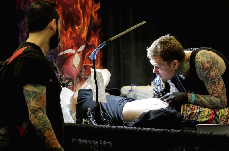 VANCOUVER, April 29, 2017 - A tattoo artist works during the 9th Vancouver Tattoo and Culture Show in Vancouver, Canada, April 28, 2017. The Vancouver Tattoo and Culture Show is an annual event that ...