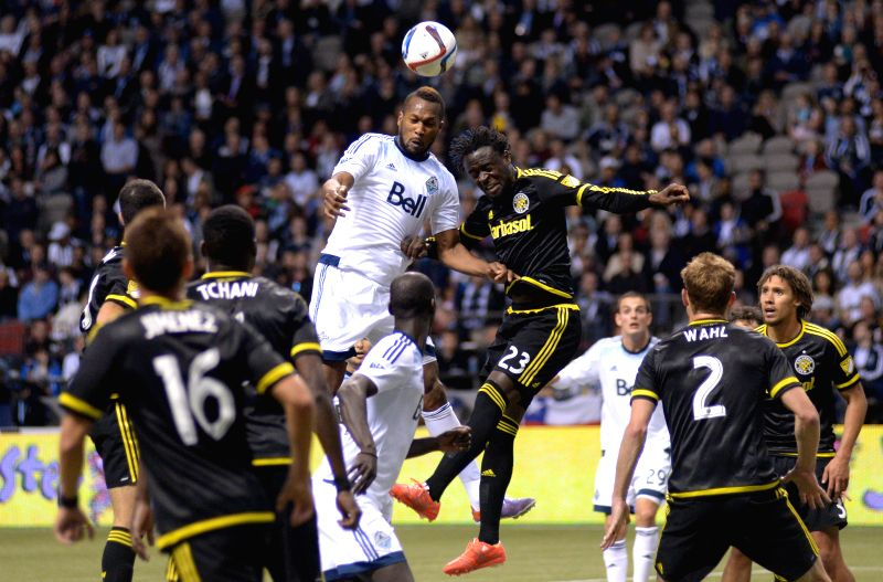 Vancouver Whitecaps' Kendall Waston (top L) vies with Columbus Crew's Kei Kamara during their MLS soccer game at BC Place in Vancouver, Canada, April 8, 2015. Vancouver ...