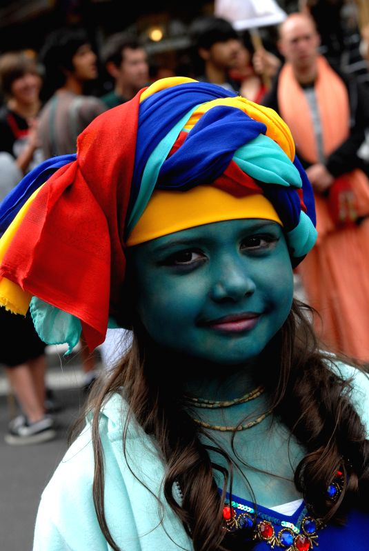 A girl poses during the 41st annual Chariots Fest of India parade and celebrations in Vancouver, Canada, Aug.10, 2014. The functional purpose of Chariots Fest of .