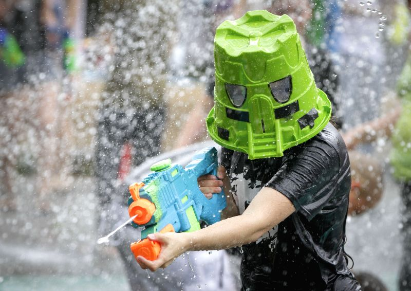 VANCOUVER, Aug. 12, 2018 - A participant enjoys the annual water fight at Stanley Park in Vancouver, Canada, on Aug. 11, 2018.