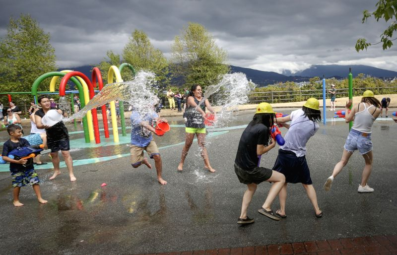 VANCOUVER, Aug. 12, 2018 - People enjoy the annual water fight at Stanley Park in Vancouver, Canada, on Aug. 11, 2018.