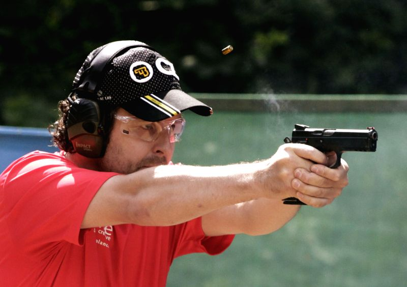 An athlete competes in the International Practical Shooting Confederation (IPSC) Canada National Championships at the Thompson Mountain Sportsmen Association in ...