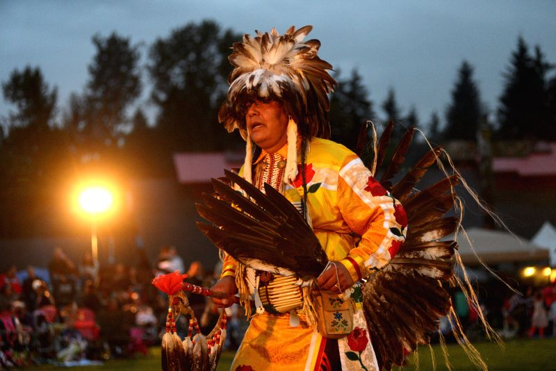 A native Indian man participates in the 27th annual Squamish Nation Pow Wow in west Vancouver, Canada, Aug. 29, 2014. A modern Pow Wow is a historically ...