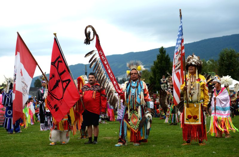 Native Indian men participate in the 27th annual Squamish Nation Pow Wow in west Vancouver, Canada, Aug. 29, 2014. A modern Pow Wow is a historically traditional .