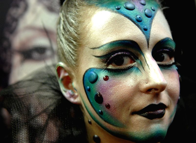 A model shows her make-up during the 2014 International Make-Up Artist Trade Show (IMATS) in Vancouver, Canada, Aug. 9, 2014.