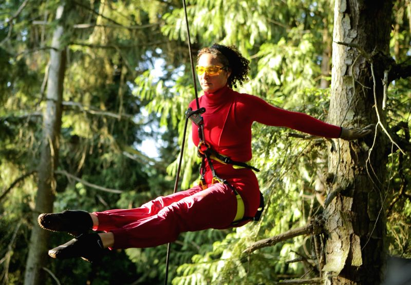 VANCOUVER (CANADA), Aug. 21, 2014 A dancer from Aeriosa Dance Society performs in the air inside a forest at University of British Columbia in Vancouver, Canada, Aug. 20, 2014. The ...
