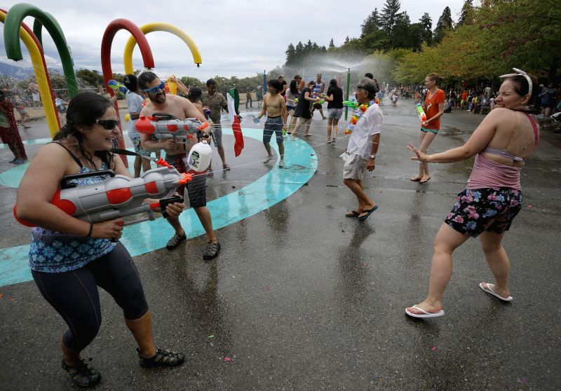 VANCOUVER (CANADA), Canada, Aug. 9, 2015  - People attack each other with water guns during the 9th Vancouver Water Fight at Stanley Park in Vancouver, Canada, Aug. 8, 2015. Over 500 people ...