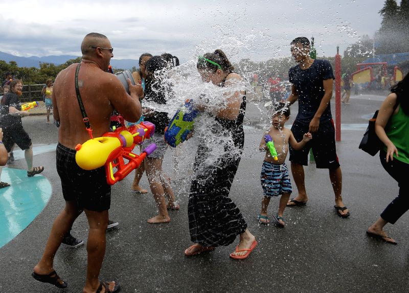 VANCOUVER (CANADA), Canada, Aug. 9, 2015  - People take part in the 9th Vancouver Water Fight at Stanley Park in Vancouver, Canada, Aug. 8, 2015. Over 500 people in all ages participated in ...