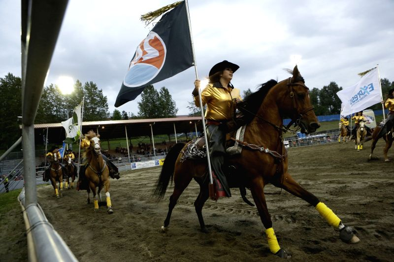 VANCOUVER (CANADA), May 17, 2014 Cowgirls perform horse riding at the Cloverdale Rodeo event in Surrey Vancouver, Canada, May 16, 2014. The 68th annual Cloverdale Rodeo is one of the ...