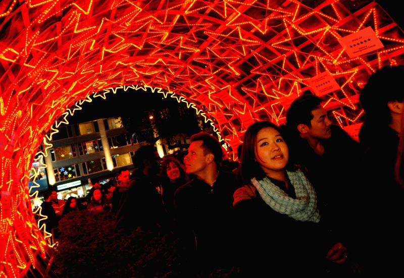 Vancouver (Canada): People attend the Christmas Lights of Hope charity initiative at St. Paul's Hospital in Vancouver, Canada, Dec. 6, 2014. The 17th annual fireworks display kicked off the annual ...
