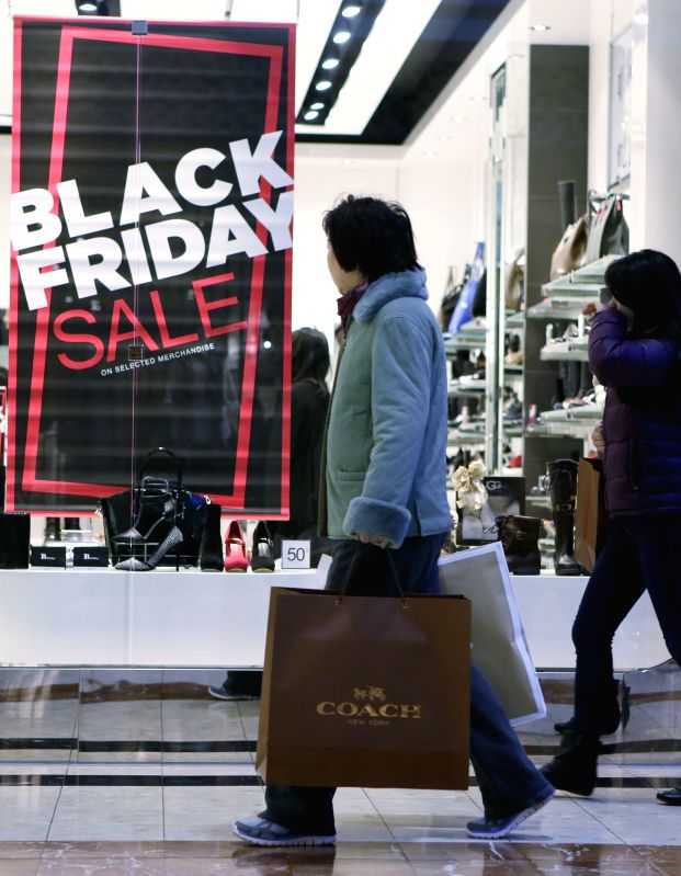 Vancouver (Canada): Residents shop for discount goods during the Black Friday event at a shopping mall in Vancouver, Canada, Nov. 28,  2014. Black Friday sales has become one of the most important ...